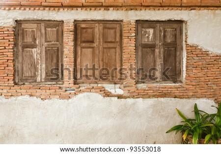 Old wooden window on old brick wall