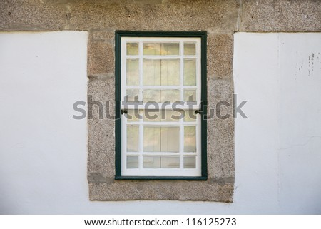 old wooden window over traditional stone