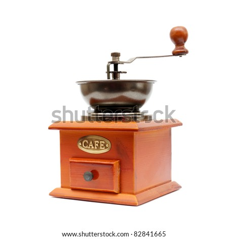 old wooden worm eaten coffee mill isolated on a white background