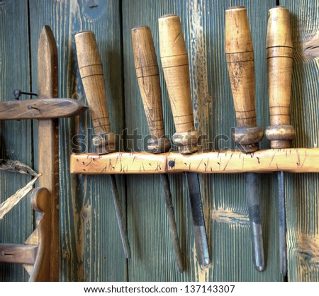 old woodworking tools on wall