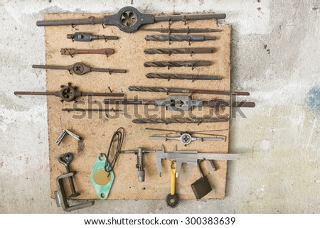 old work tools hanging in wall garage
