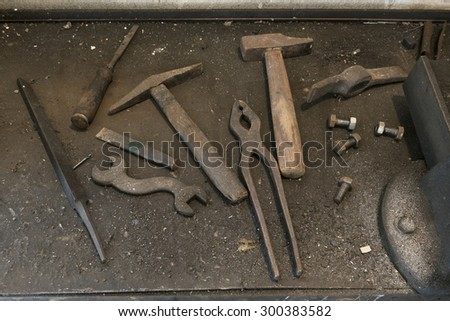 old workbench with old work tools in home garage