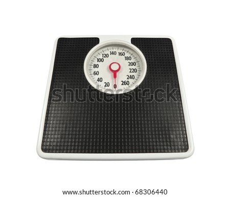 Old, worn bathroom scale ready to deliver the news. - stock photo