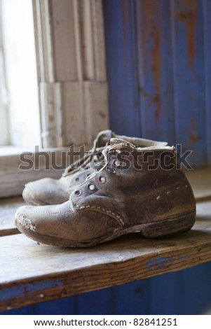 Old worn boots on the floor