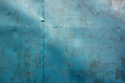 Old worn metal surface with paint. Rusty metal texture. Metal sheet with rust and worn paint. Background. Metal. Wall. Floor.