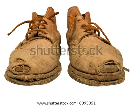 Old worn out boots - stock photo