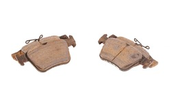 Old worn out brake pads from a car on a white background, isolate, close-up. Quality of friction linings