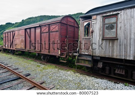 Old worn out railway carriage with broken windows