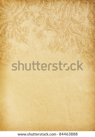 Old worn paper with floral ornament