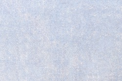 Old worn velvet of a yellow-blue shade. The texture of the fabric with fine threads, hairs and stripes.