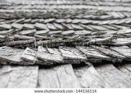 old worn wooden shingle roof pattern - close up