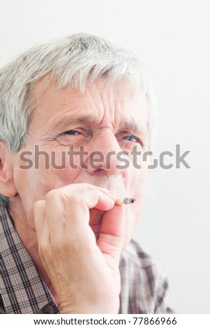 old worried and thinking man smoking