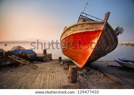 Old wreck in Koroni harbor in Greece