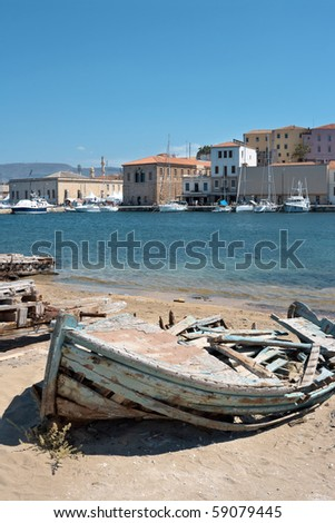 Old wrecked boat in the harbour of Chania. Crete, Greece