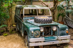 old wrecked jeep that is being used as kid toy, decorative vintage objects