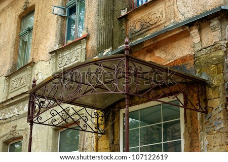 Old Wrought Iron Canopy Over The Door Of An Old House