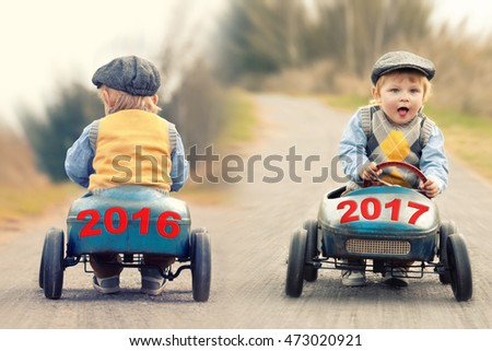 old year 2016 on a vintage old toy car leaving, new year 2017 on a vintage old toy car is coming