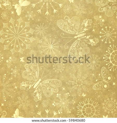Old yellow christmas paper with snowflakes and  butterflies