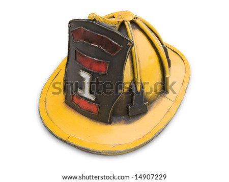 Old yellow fireman helmet isolated on white.