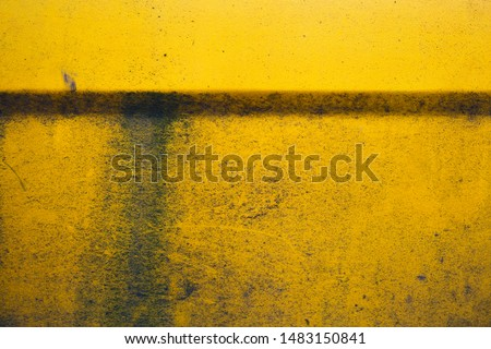 Old yellow grunge background. Dirty wallpaper