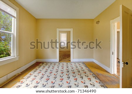 Old yellow living room, empty. Build in 1907 old farm house in Ashford, Washington State near Mt. Ranier.