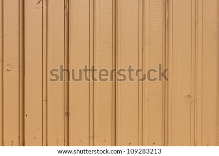 Old yellow painted wooden wall background - stock photo