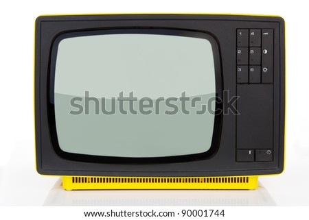 Old yellow retro styled television from 1970's isolated on white background. Retro concept.