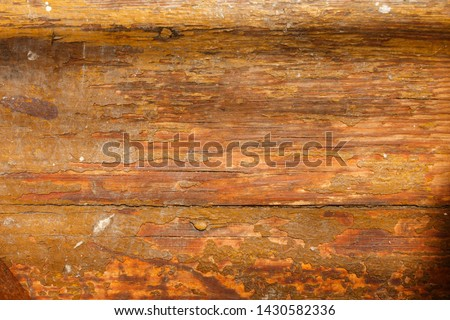 old yellow ruined wooden board texture. old wooden background with scratches and dust. Scratched raunchy wood flooring with lacquer peeled off