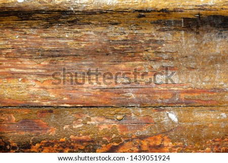 old yellow ruined wooden board texture. old wooden background with white scratches and dust. Scratched raunchy wood flooring with lacquer peeled off