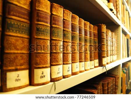 old yellow vintage books in library showing education concept