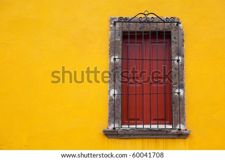 Old yellow window in old town. Mexico