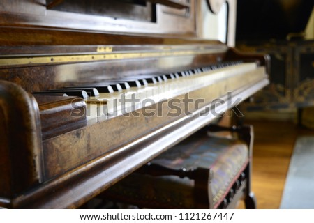 Old, yellowed keys of antique piano #1121267447