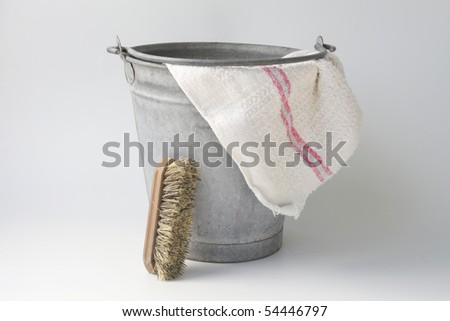 Old zinc bucket with floor cloth and brush