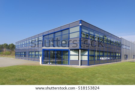 OLDENZAAL, NETHERLANDS - APRIL 9, 2016: exterior of a modern office building under a clear blue sky