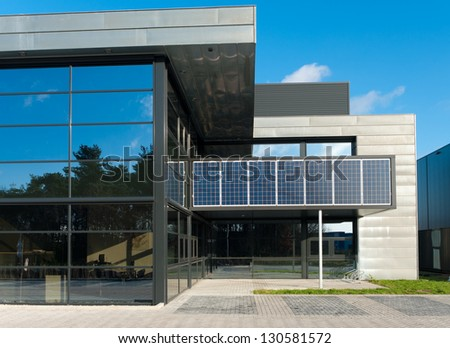 OLDENZAAL, NETHERLANDS - DEC12: Office with solar panels on december 12, 2011 in Oldenzaal, Netherlands. In 2013 government subsidizes 4 billion euros for companies who invest in sustainable energy