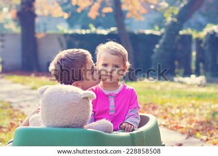 Older brother comforting her little sister