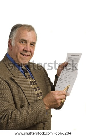 older businessman holding contract for client to sign, isolated on white