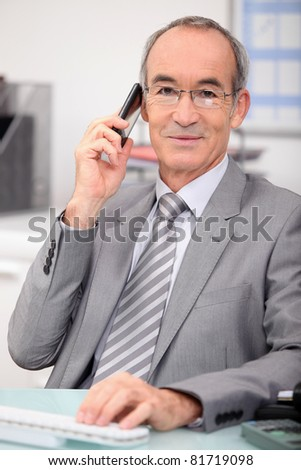 Older businessman using a cellphone