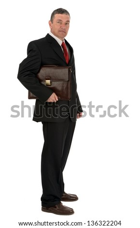 Older businessman with briefcase isolated on white background