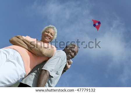 Older Couple Flying Kite