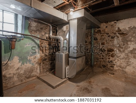 older home has furnace system repaired for the winter ストックフォト ©