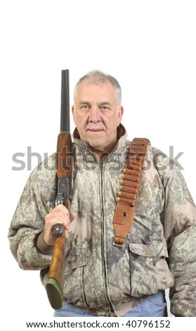 Older hunter in sage camouflage with shotgun and ammo belt over shoulder isolated on white