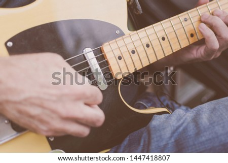 Older male musician playing guitar on a New York City Street #1447418807