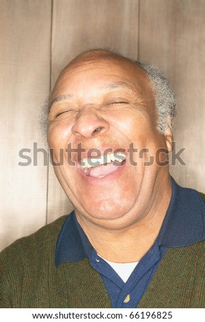 Older man laughing