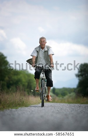 older man on his bicycle in the countryside