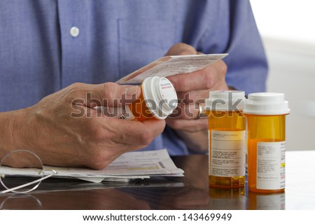 Older man with prescription medications.