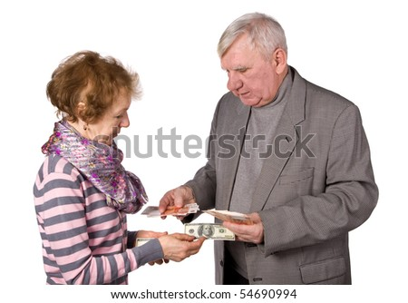 Older persons with money in hands. It is isolated on a white background