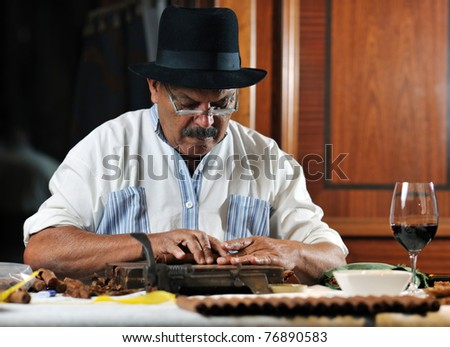 older senior man making luxury handmade cuban cigare - stock photo