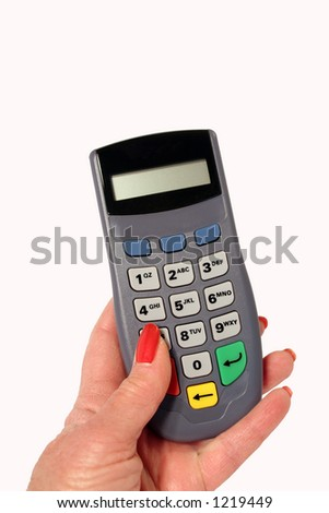 older woman's hand holding key pad