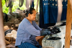 Older women dyeing cotton with natural indigo. Local Master are the original Indigo Cotton Weaving in the community of Sakon Nakhon province.